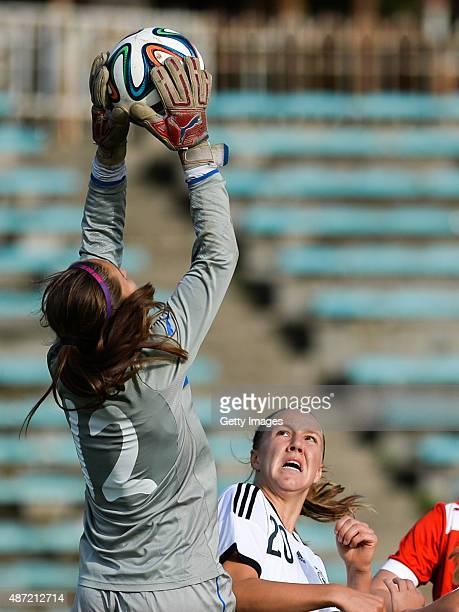 Vanessa Ziegel of Germany challenges Maryaia Svidunovich of Belarus during the U17 Girl's international UEFA tournament match between U17 Girl's...