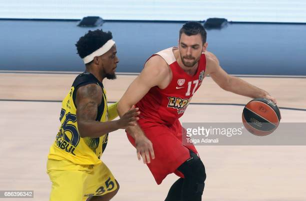 Vangelis Mantzaris #17 of Olympiacos Piraeus competes with Bobby Dixon #35 of Fenerbahce Istanbul during the Championship Game 2017 Turkish Airlines...