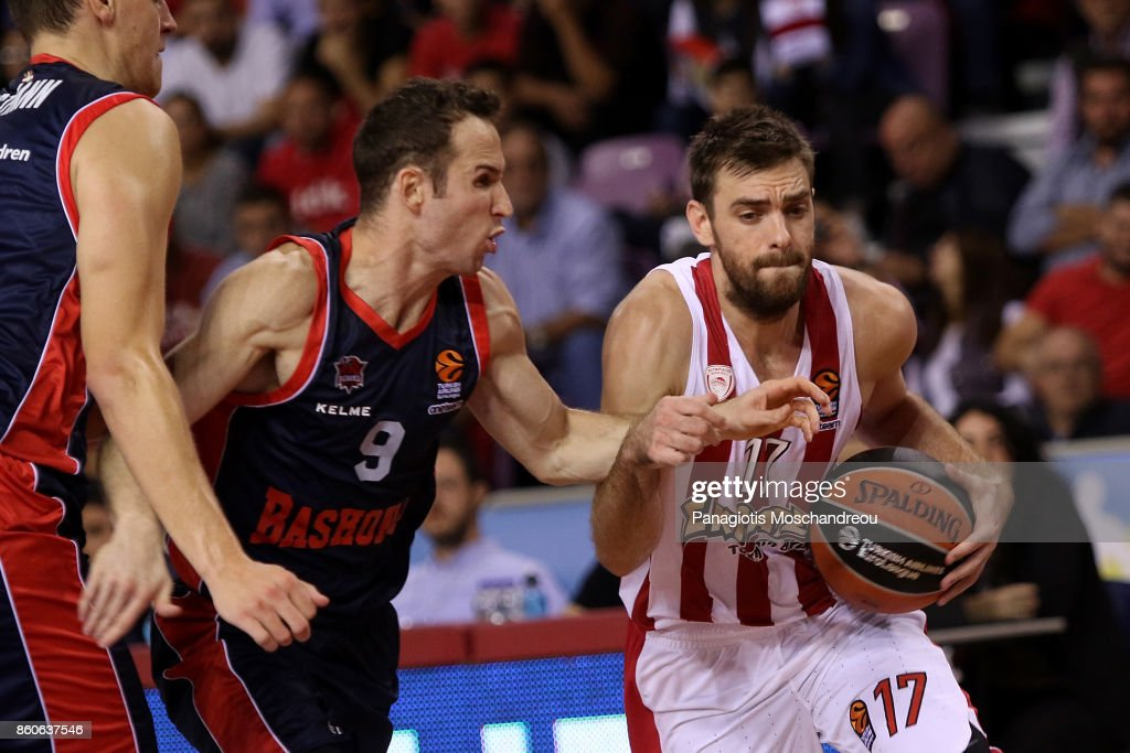 Vangelis Mantzaris, #17 of Olympiacos Piraeus competes with Marcelinho Huertas, #9 of Baskonia Vitoria Gasteiz during the 2017/2018 Turkish Airlines EuroLeague Regular Season Round 1 game between Olympiacos Piraeus v Baskonia Vitoria Gasteiz at Heraklion Arena on October 12, 2017 in Heraklion, Crete, Greece.
