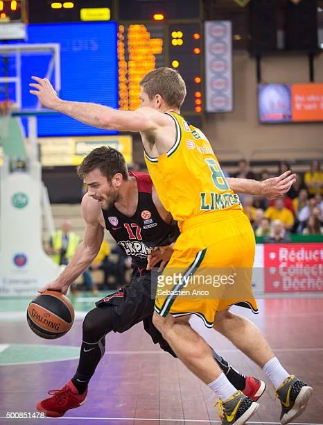 Vangelis Mantzaris #17 of Olympiacos Piraeus competes with Matt Gatens #8 of Limoges CSP during the Turkish Airlines Euroleague Basketball Regular...