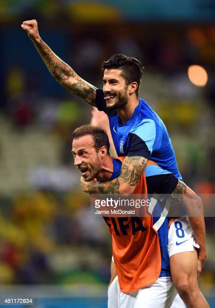 Vangelis Moras and Panagiotis Kone of Greece celebrate after defeating the Ivory Coast 21 during the 2014 FIFA World Cup Brazil Group C match between...