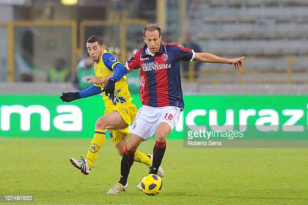 Vangelis Moras of Bologna shields the ball from Mariano Bogliacino of Chievo during the Serie A match between Bologna and Chievo at Stadio Renato...