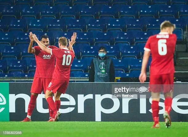 Vangelis Pavlidis and Dani de Wit of AZ Alkmaar celebrate after scoring their second goal during the UEFA Conference League match between Randers FC...