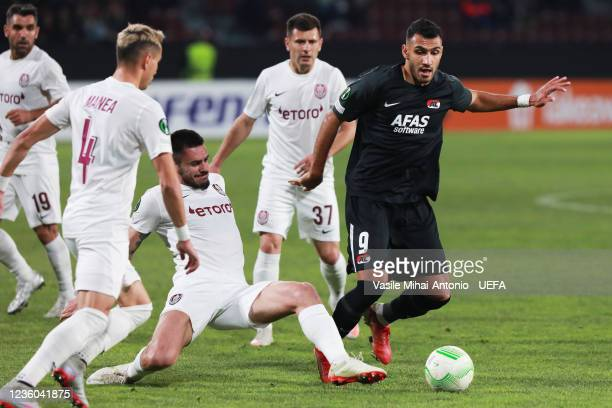 Vangelis Pavlidis of AZ Alkmaar is challenged by Andrei Burca of CFR Cluj during the UEFA Europa Conference League group D match between CFR Cluj and...