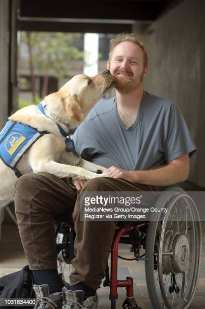 Vanguard University Chemistry Professor John Terhorst and his service dog Yan in Costa Mesa Terhorst sustained spinal cord damage in 2011 and has...