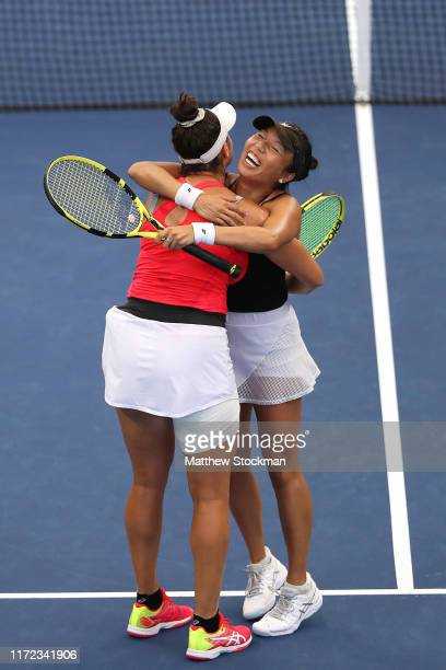 Vania King and Caroline Dolehide of the United States celebrates after defeating Jelena Ostapenko of Latvia and Lyudmyla Kichenok of the Ukraine...