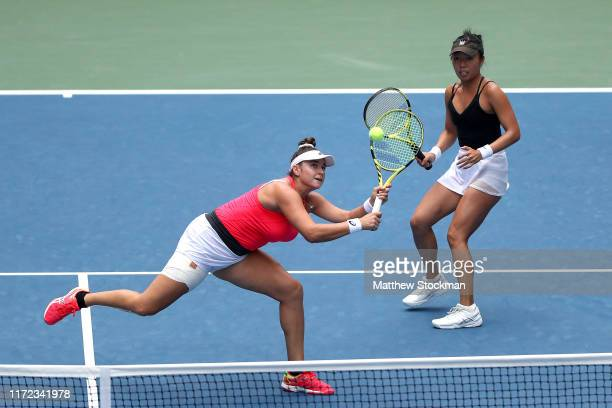 Vania King and Caroline Dolehide of the United States in action against Jelena Ostapenko of Latvia and Lyudmyla Kichenok of the Ukraine after their...