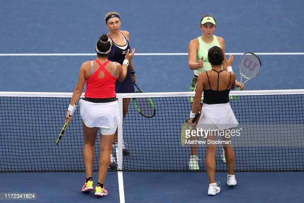 Vania King and Caroline Dolehide of the United States shake hands with Jelena Ostapenko of Latvia and Lyudmyla Kichenok of the Ukraine after their...