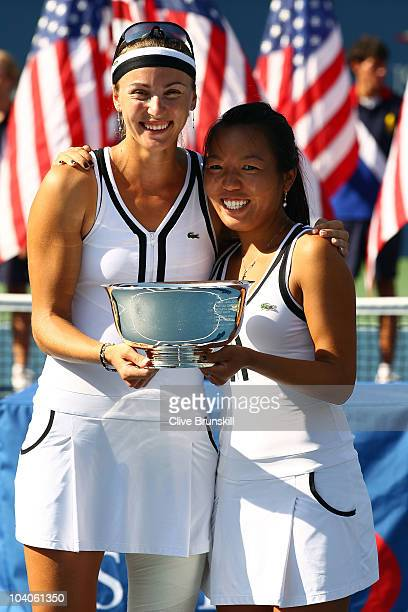Vania King of the United States and Yaroslava Shvedova of Kazikstan celebrate with their throphy after defeating Liezel Huber and Nadia Petrova of...