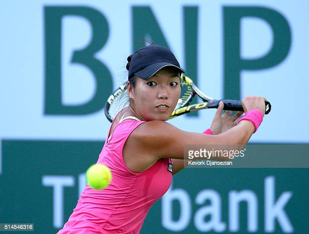 Vania King of the United States hits a backhand against Taylor Townsend of the United States during day three of the BNP Paribas Open at Indian Wells...