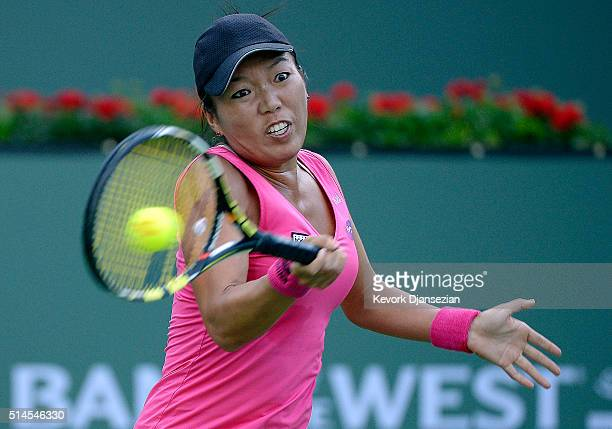 Vania King of the United States hits a forehand against Taylor Townsend of the United States during day three of the BNP Paribas Open at Indian Wells...