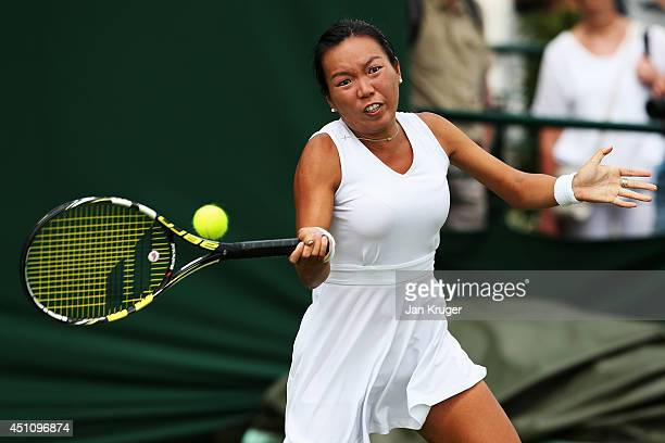 Vania King of the United States plays a forehand during her Ladies' Singles first round match against Yvonne Meusburger of Austria on day one of the...