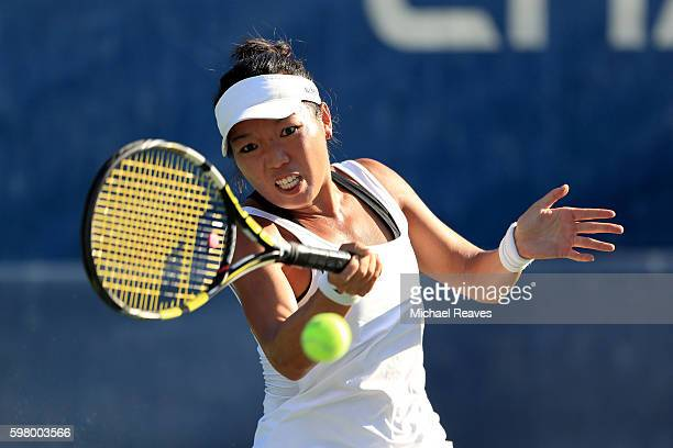 Vania King of the United States returns a shot to Antonia Lottner of Germany during her first round Women's Singles match on Day Two of the 2016 US...