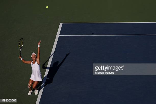Vania King of the United States serves to Antonia Lottner of Germany during her first round Women's Singles match on Day Two of the 2016 US Open at...
