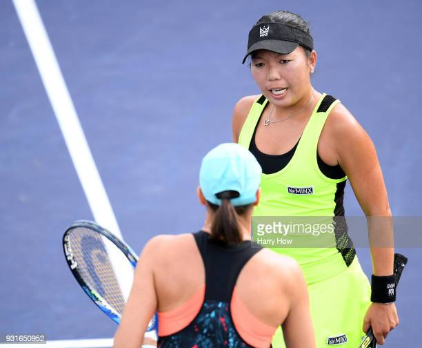 Vania King of the United States talks with Katarina Srebotnik of Slovenia in their match against SuWei Hsieh of Chinese Taipei and Barbora Strycova...