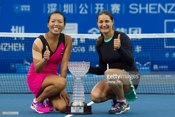 Vania King of the US and Monica Niculescu of Romania poses with the trophy after Women's doubles final match against Xu Yifan of China and Zheng...