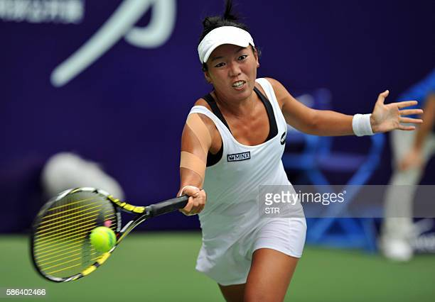 Vania King of the US hits a return against Risa Ozaki of Japan during their women's singles semifinal match at the Jiangxi Open WTA tennis tournament...