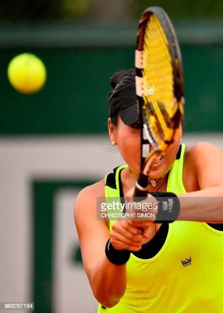Vania King of the US plays a return to Romania's Mihaela Buzarnescu during their women's singles first round match on day two of The Roland Garros...