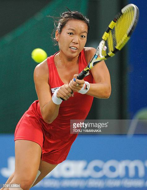 Vania King of the US stretches for a return against Marion Bartoli of France during their second round match at the Japan Women's Open tennis...