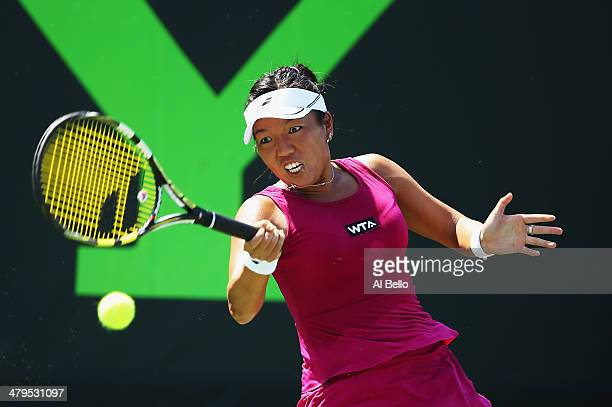 Vania King of the USA returns the ball to Estrella Cabeza of Spain during their match on day 3 of the Sony Open at Crandon Park Tennis Center on...