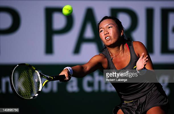 Vania King of the USA returns to Sara Errani of Italy during the first round of the BNP Paribas Open at the Indian Wells Tennis Garden on March 7,...