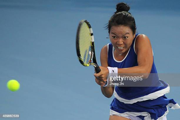 Vania King of United States returns a shot during her match against Sara Errani of Italy on day five of the WTA Shenzhen Open at Shenzhen Longgang...