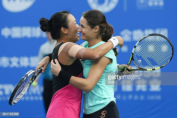 Vania King of USA and Monica Niculescu of Romania celebrate during a match against Xu Yifan of China and Zheng Saisai of China in Women's doubles...