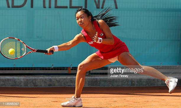 Vania King of USA stretches for a forehand in her match against Bethanie MattekSands of USA during day four of the Mutua Madrilena Madrid Open Tennis...