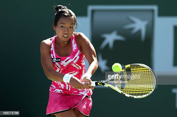 Vania King returns to Silvia SolerEspinosa of Spain during day 1 of the BNP Paribas Open at Indian Wells Tennis Garden on March 6 2013 in Indian...
