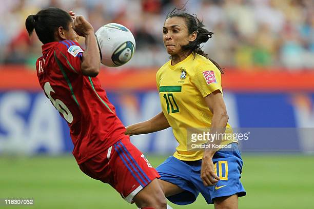 Vania of Equatorial Guinea challenges Marta of Brazil during the FIFA Women's World Cup 2011 Group D match between Equatorial Guinea and Brazil at...