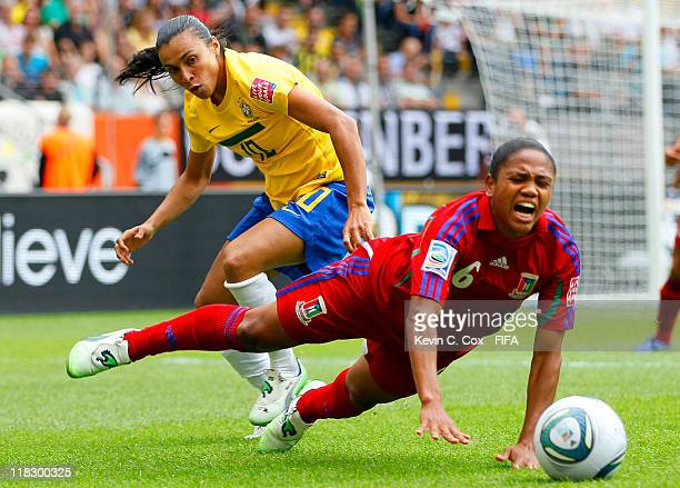Vania of Equatorial Guinea is fouled by Marta of Brazil during the FIFA Women's World Cup 2011 Group D match between Equatorial Guinea v Brazil at...