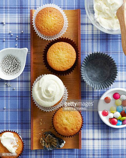 Vanilla cupcakes with selection of toppings and decoration