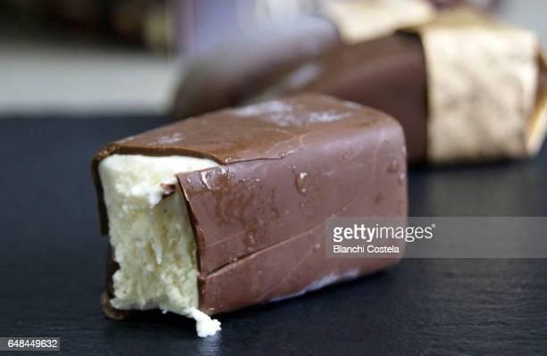 Vanilla ice cream covered with chocolate
