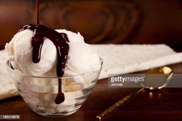 Vanilla ice cream with chocolate syrup, gold spoon
