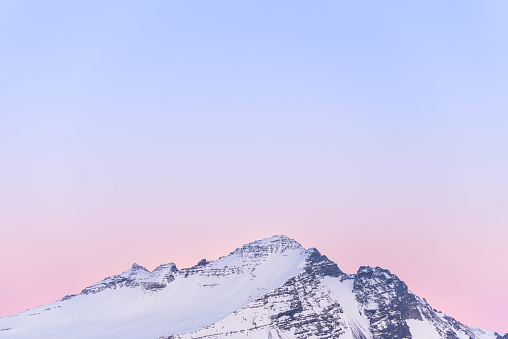 Vanilla sky and the snowcapped mountain in Iceland during the sunset - gettyimageskorea