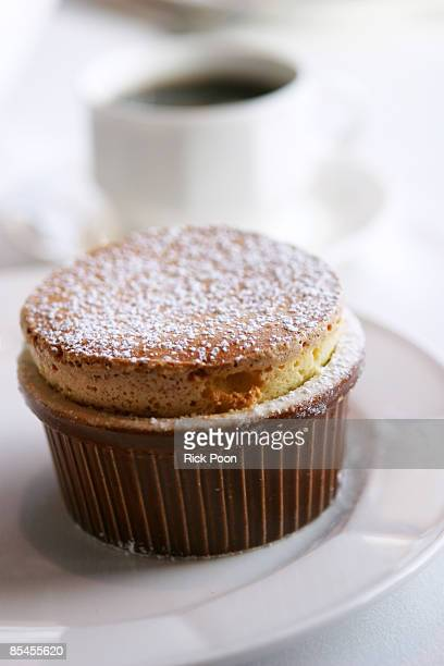 Vanilla souffle with powdered sugar in ramekin