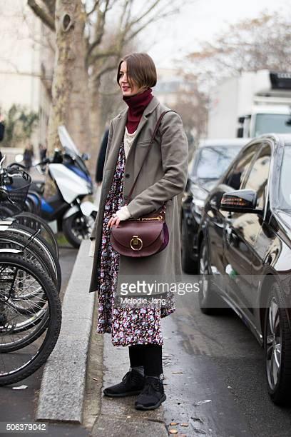 Vanille Verloes fashion designer wears a Margiela coat Zadig Voltaire turtleneck Chloe bag and her own floral dress on January 22 2016 in Paris France