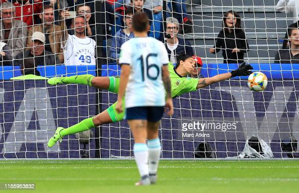 Vanina Correa of Argentina saves a penalty from Nikita Parris of England during the 2019 FIFA Women's World Cup France group D match between England...