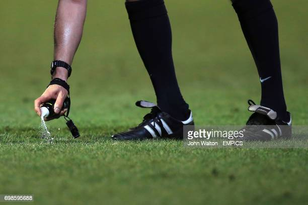 Vanishing spray is applied by the referee before a free kick.