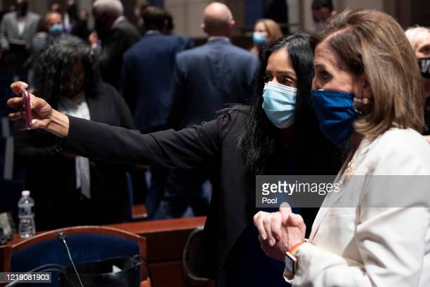 Vanita Gupta, CEO of the Leadership Conference for Civil Rights, poses for a selfie with U.S. House Speaker Nancy Pelosi beforea House Judiciary...
