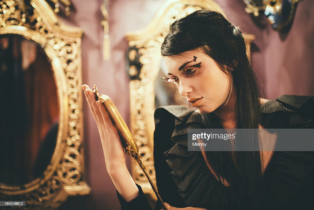 Vanity Black Snow White and a Golden Mirror : Stock Photo