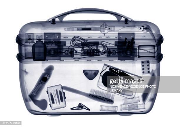 vanity case with contents, x-ray - consolador fotografías e imágenes de stock