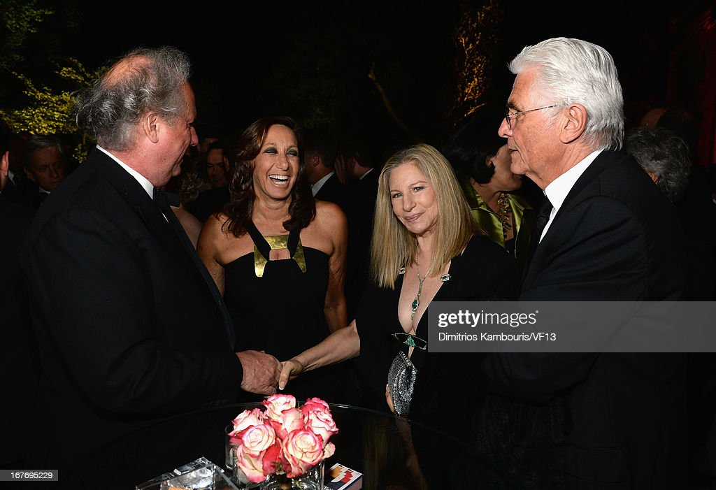 Vanity Fair Editor Graydon Carter, designer Donna Karan, Barbra Streisand and James Brolin attend the Bloomberg & Vanity Fair cocktail reception following the 2013 WHCA Dinner at the residence of the French Ambassador on April 27, 2013 in Washington, DC.