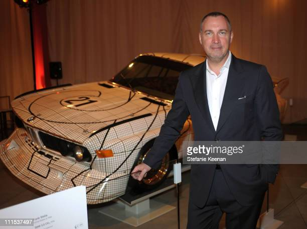 Vanity Fair publisher Edward Menicheschi admires the BMW Art Car by Frank Stella at a celebration hosted by Vanity Fair at LACMA on February 18 2009...