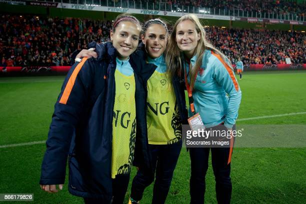 Vanity Lewerissa of Holland Women, Angela Christ of Holland Women, Desiree van Lunteren of Holland Women celebrate the victory during the World Cup...