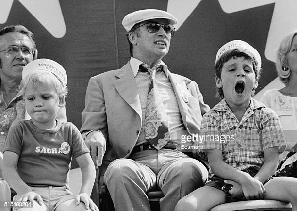 Vanleek Hill Ontario Canada Prime Minister Pierre Trudeau and son Justin age 6 1/2 and Sacha age 4 1/2 watch the parade during celebrations here of...