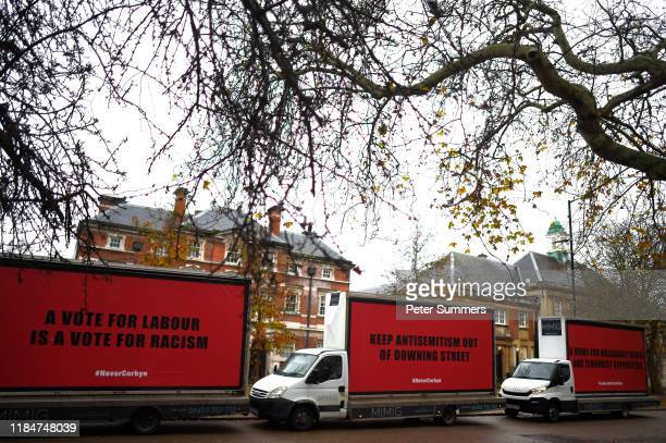 Vans belonging to The Community United against Labour Party antiSemitism group Culpa arrive ahead of the Labour Race and Faith Manifesto launch on...
