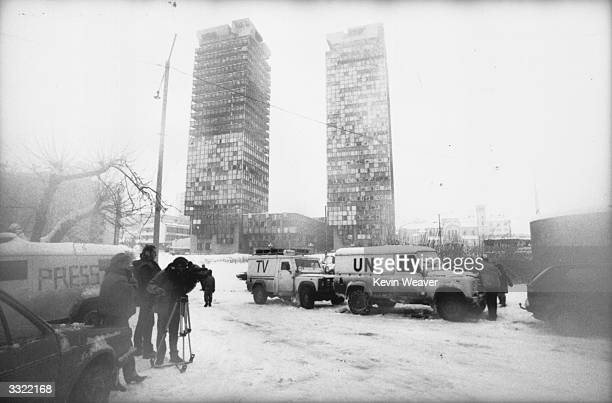 Vans belonging to the UN and a television company parked outside the Holiday Inn at Sarajevo, where most journalists are staying, during civil war in...