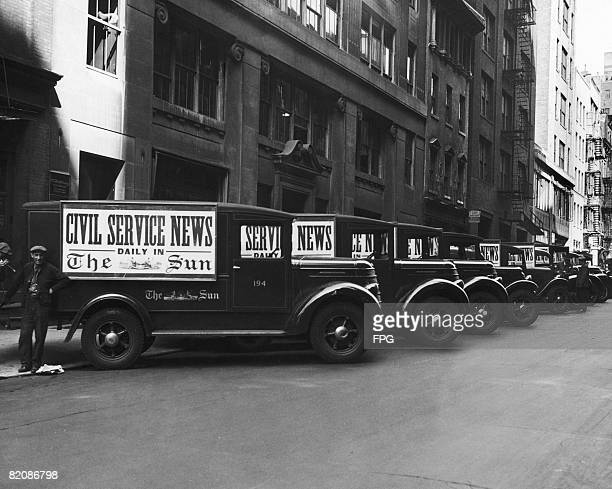 Vans parked outside the headquarters of The Sun newspaper in New York City advertising the Civil Service News circa 1930
