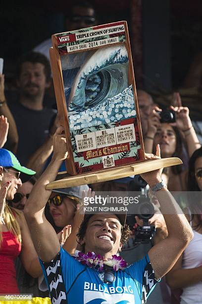 Vans Triple Crown and Pipe Masters Champion Julian Wilson of Australia holds up his trophy during the awards ceremony on final day of the Billabong...